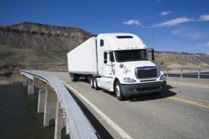 White Semi driving the bridge